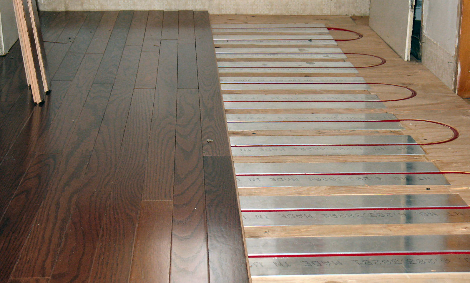Energy efficient heating radiant floor installation from for Hardwood floor panels