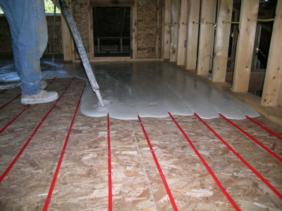 Tubing Over Plywood With Gypsum Pour Is Stapled Down The Subfloor And Would Then Be Covered By A Thin Of Light Weight